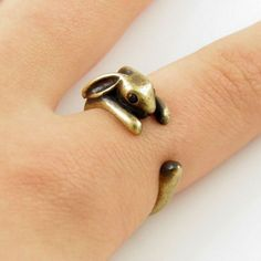 This ring is made in the shape of a bunny that wraps around your finger. They are one size fits all and are plated in silver and bronze. This is perfect for anyone looking for unique cute animal theme