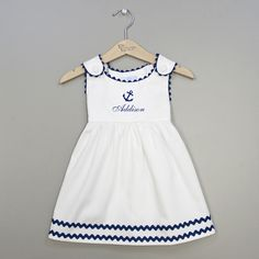Adorable and stylish, we have added an anchor to this white pique dress to give it a classic nautical theme.  Perfect for summer days at the beach or on the boat.  Add a name and we will embroider it under the anchor.  If you choose to leave the name blank, your dress will come with the anchor.