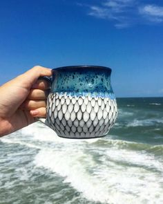 A fun ocean-inspired ceramic mug by the talented @Claybycole.