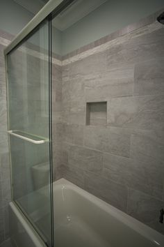 custom shower with 12 x 24 tiles
