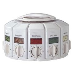 "Twelve-canister spice carousel that dispenses premeasured amounts.  Product: Spice carouselConstruction Material: PlasticColor: WhiteFeatures:  Dispenses premeasured amounts of spices4.5 Ounce capacity each Dimensions: 6.75"" H x 9.5"" Diameter (overall)"