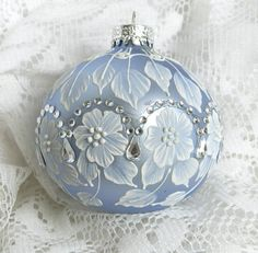 Powder Blue Hand Painted 3D Floral Design MUD Ornament with Rhinestone Bling. $27.50, via Etsy.