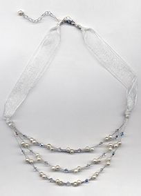 """Add a lustrous beauty to your look. This multi layered necklace is strung with freshwater pearls and Swarovski crystals. Delicate and beautiful you'll look on your special day. This necklace measures 16"""" in length with a 3"""" extender allowing you to wear it at different lengths on the neckline. Necklace shipped with a pouch for gift giving.High-quality iridescent crystals with polished surfaces that create a brilliant sparkle, reflecting the full spectrum of light.Sheer netting or veiling…"""
