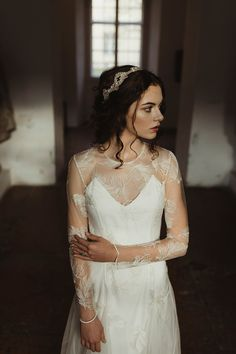 The Celestia gown and the Athene handbeaded gold lace headpiece in the Kiscell Museum