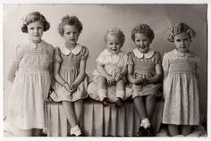 So sweet! My sister and I wore dresses just like these when we were about these little girls' age!!