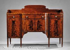 An American Federal Mahogany Cross-Banded and Inlaid Sideboard, c. 1800, Mid-Atlantic, having a shaped backsplash, the swell-front top above drawers and cross-banded cupboards, the stiles with chevron inlaid panels on turned, tapered, reeded legs, with highly figured veneers throughout, poplar and pine secondary woods, height 54 1/2 in., width 71 in., depth 25 1/2 in.