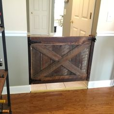 Just installed this #reclaimed #barnwood baby/dog gate.  I love how this turned out in the owners home!!! This gate is made out of 100% reclaimed oak.these can be made to fit your opening!!! #interiordesign #harvest #nashville #order #distressed #wood #woodwork #distressed #distresseddesigns #distressedfurniture #dogoodwork #dog #sawmark #shabbychic #hgtv #buylocal #maker #handmade #kregjig #titebond #babygate #barndoor #vintage #rustic #upcycle de distressed_designs15