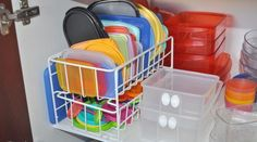 Whether you store your plastic storage containers in a drawer, cabinet, or some other hidden spot in your kitchen, we're going to take a guess that it is one of your least favorite places to organize. While we're not promising that any one organizing trick will keep that Tupperware tamed, these seven ideas can help keep things a bit more in order.