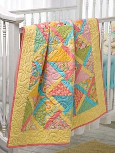 Twist & Turn Quilt Pattern Download from e-PatternsCentral.com -- You can make this quilt quickly using precut triangles. For a different look, try mixing blacks and whites, or stripes and a single solid color.
