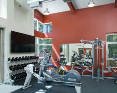 Red and white home gym colors Love the centered weights under centered tv just above