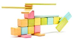 Tegu Tints - a new set of colorful magnetic wood blocks - built using sustainably harvested tropical hardwood.