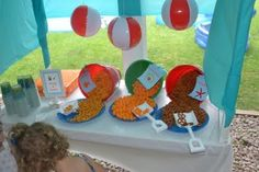 Cute food display for a pool party. Hanging pool toys for cute and inexpensive decorations.