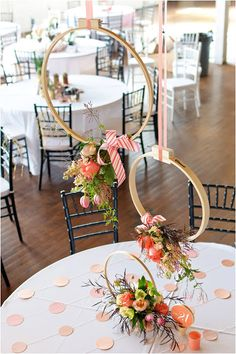 Embroidery hoops used to hang flowers, also love the table decoration with linked monochromatic polkadots (could make with string and paper or paint chip cut outs)