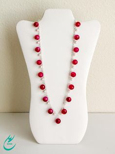Item#0919  Faceted gorgeous fuchsia color Agate gemstone beads are hand wrapped individually to a beautiful sterling silver cable chain. There are white Swarovski crystal pearls that are hand wrapped and placed in between each fuchsia stone. The white pearls create a soft and feminine style to the necklace. The color of this gemstone beads are so vivid and saturated, and each Agate stone has its own unique coloring/marbling effect with different shades of light and dark fuchsia.   The ne...