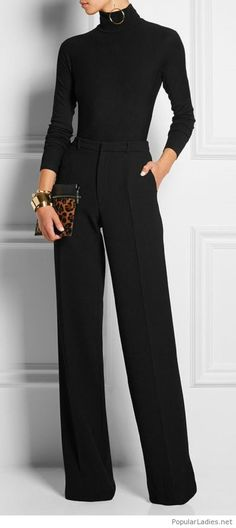 Black blouse and pants with a leo bag and many accessories
