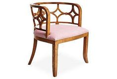 A stunning chair with a chic pink cushion perfect for a pop of color!