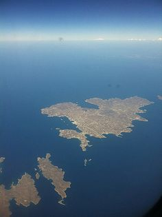 Spot Mykonos and Delos from the Sky.