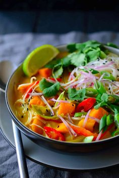 This vegetarian Thai soup is a hearty dish brimming with vegetables, rice noodles and herbs in a sweet, savoury and spicy coconut broth. It's easy to make with a vegan store-bought curry paste and you won't need any exotic ingredients to get this delicious soup on the table in just 20 minutes!