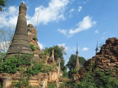 The crumbling stupas of Nyaung Ohak Monastery are beside the trail to Inn Dein, southwest of Inle Lake, Myanmar (Burma). Inle Lake, Barcelona Cathedral, Trail