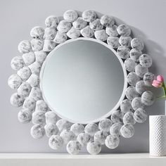 This mirror reflects the hard work of makers who distress the aluminum frame by hand, allowing the dark base to emerge. By makers with Noah's Ark, a fair trade handicraft business in India. The cost of metal has skyrocketed in recent years, which has had a devastating effect on the local economy and on the lives of individual makers. Noah's Ark has worked hard to train artisans in using alternative metals and material.