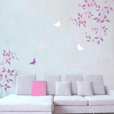 Immagine di http://fotogallery.donnaclick.it/images/2014/07/Decorare-le-pareti-con-gli-stencil-rami-con-foglie-e-farfalle-svolazzanti-per-la-sala.jpg.