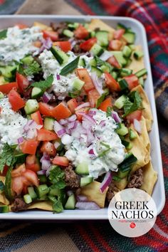This weekend we feasted on these Greek Nachos and I gotta tell you they are ahhhhhmazing! Instead of tortilla chips, this recipe calls for pita chips as its base. Building up from there, it's cumin spiced lamb, feta tzatziki sauce and heaps of fresh veggies & zesty olives.