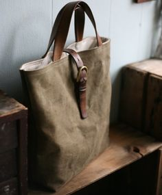 Recycled Canvas Tote Bag by Forestbound on Etsy. Canvas salvaged from a military duffel bag, leather strap and buckle from a belt.
