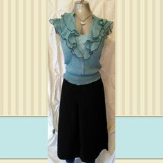 Blue and black ruffled blouse w/ built in cami BLUE & BLACK RUFFLED BLOUSE SHIRT TOP W\BUILT IN CAMI  EXCELLENT CONDITION NO FLAWS   MEASUREMENTS LAYING FLAT CHEST 15.5 IN. LENGTH 20 IN.  BLOUSE AND CAMI ARE BOTH 100% POLYESTER  ALSO POSTED ON OTHER SITES BCX Tops Blouses