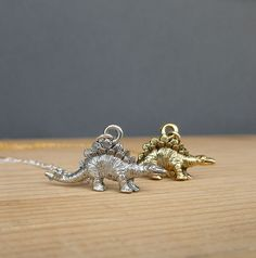 gold or silver stegosaurus dinosaur necklace 14kt gold filled or sterling silver chain. $25.00, via Etsy.