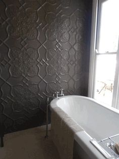 Shield pattern Pressed metal wall cladding and vintage bathtub. House Plans & Design by Empire Design & Drafting.