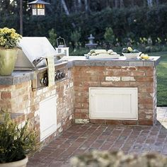 Sleek Outdoor Buffet...Slate countertops in this kitchen double as a food prep area and a buffet space where visitors can mingle and munch. The brick and stainless-steel grill are good materials for outdoor use and offer a sleek look.