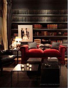 Bachelor pad / masculine interior design & decor / library den, black walls, red velvet sofa