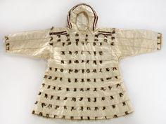 Siberian Yupik Man's raincoat, ca. 1920. Bering Straits, Alaska. Sea mammal gut/intestines, crested auklet scalps with beaks, cotton cloth, fur