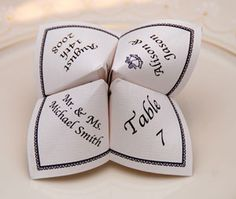 origami wedding fortune teller table cards. cute!