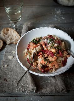 shrimp, roasted tomatoes, fettucini, basil, parm…  (via browndresswithwhitedots)
