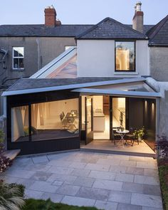 Prism-like wood and glass panels replace a musty conservatory in Dublin.
