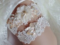 A personal favorite from my Etsy shop https://www.etsy.com/listing/255023345/venise-lace-wedding-garter-set-with