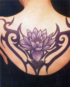 love the delicate lotus flower  and the power of the tribal art