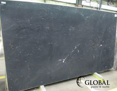 Dusk Honed quartzite. Charcoal grey background with white quartz deposits. Visit globalgranite.com for your natural stone needs.