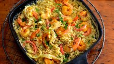 Try this easy recipe for Coconut Curry Shrimp, made with rice. It's so simple to make when you're wondering what's for dinner tonight! Season shrimp with curry powder and cook until they turn pink. Then, cook onion, red pepper,  remaining curry, and garlic. Stir coconut milk and Knorr® Asian Sides™ - Chicken flavor Fried Rice and cook until rice is tender. Stir in shrimp and then sprinkle with cilantro before serving.
