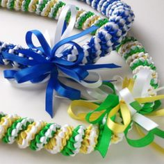 Handmade ribbon leis made with love. @ LoveLeis on instagram. Crafted for the guest of honor in your life.