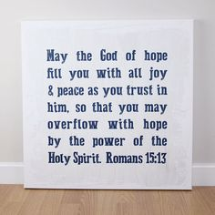 A striking canvas featuring words from Romans 15. This canvas is a bold statement on a wood effect background with a rustic finish.  Printed on fine canvas with 38mm gallery stretcher bars. Hand stretched and finished. Each canvas is supplied with a hanging fixing.
