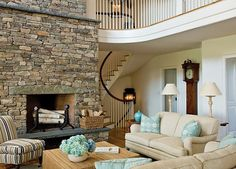 rustic living room design stone fireplace upholstered sofa armchairs decorative…