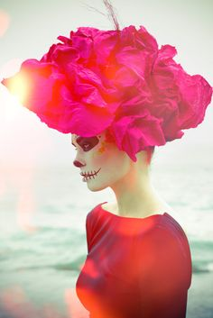 Neon fuchsia and face-painted skeleton.