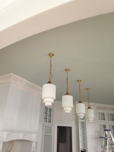 Vintage Brass Pendants used in new construction, Amazing! Regina Garcia Design