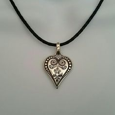 Brighton Ophelia Necklace Heart Pendant Gently used Brighton necklace is adjustable. The metal is multi tone with a black rope. Overall straight line length is 17 1/2 max.  Adjustable down to 16 1\2 with 10 islet loops. Jewelry Necklaces