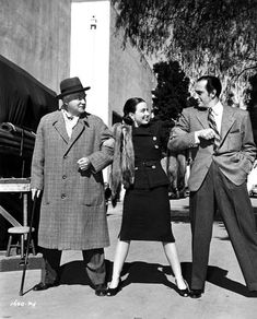Nigel Bruce, Patricia Morison and Basil Rathbone between scenes ofDressed to Kill