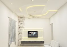 Simple Elegant Tv Unit designed for small space by Scaleinch Pvt. Plaster Ceiling Design, House Ceiling Design, Ceiling Design Living Room, Bedroom False Ceiling Design, Small House Interior Design, Modern Home Interior Design, Small Bedroom Designs, Modern Bedroom Design, Living Tv