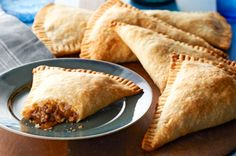 Barbecue Beef Hand Pies  1-1/2 c Big-Batch Beef, thawed  1/2 c BBQ Sauce  1 pkg. ready-to-use refrigerated pie crusts (2 crusts)  1/2 c Tex Mex Shredded Cheese  Oven @ 425.COMBINE meat & barbecue sauce.Lay out pie crust flat & cut into quarters. Spoon 1/4 c meat mixture onto ea. quarter crust; sprinkle w/1 Tbsp. cheese. Fold dough pieces lengthwise in half; crimp edges w/fork to seal.PLACE on parchment paper or foil covered rimmed baking sheet. Bake 12-15 min until golden