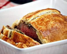 Beef Wellington is a classic English dish, comprised of a tenderloin filet of beef covered in duxelles and wrapped in puff pastry.